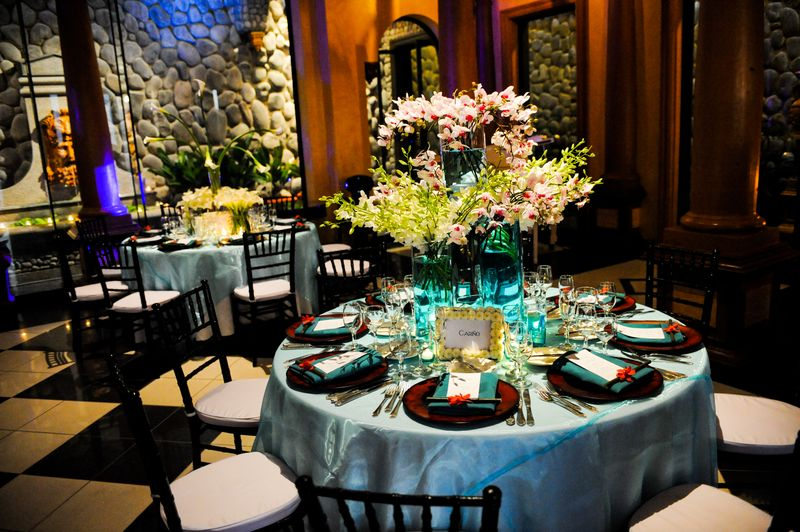 Orchid and cala, blue & white table arrangements